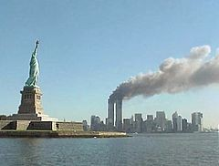 240px-National_Park_Service_9-11_Statue_of_Liberty_and_WTC_fire.jpg